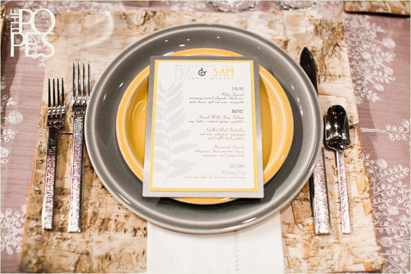 Yellow and gray table setting with Birch placemats by Bella Rugosa, Williams Sonoma, Chambers & Co and Paper Moxie. Photo by The Popes.