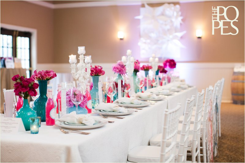 Pink and blue summer wedding table with white chivari chairs, vintage aqua glass and fushia flowers. Design by Bella Rugosa, Chambers & Co, Pederson