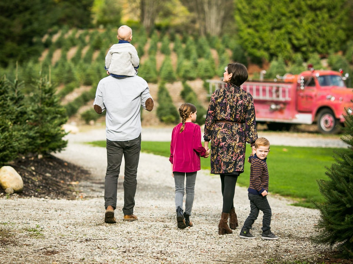 family walking together with one boy looking back