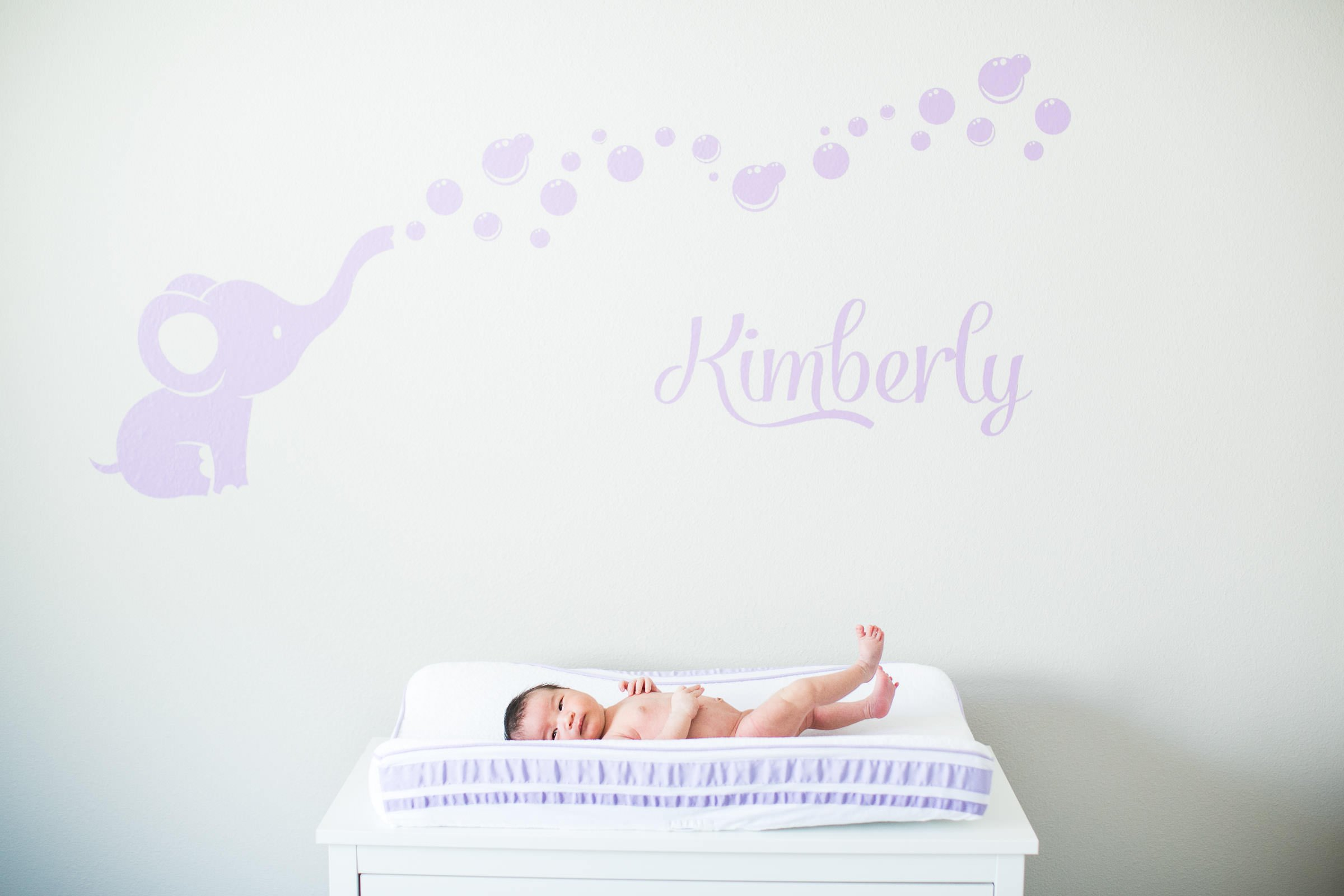 baby lying on a changing table