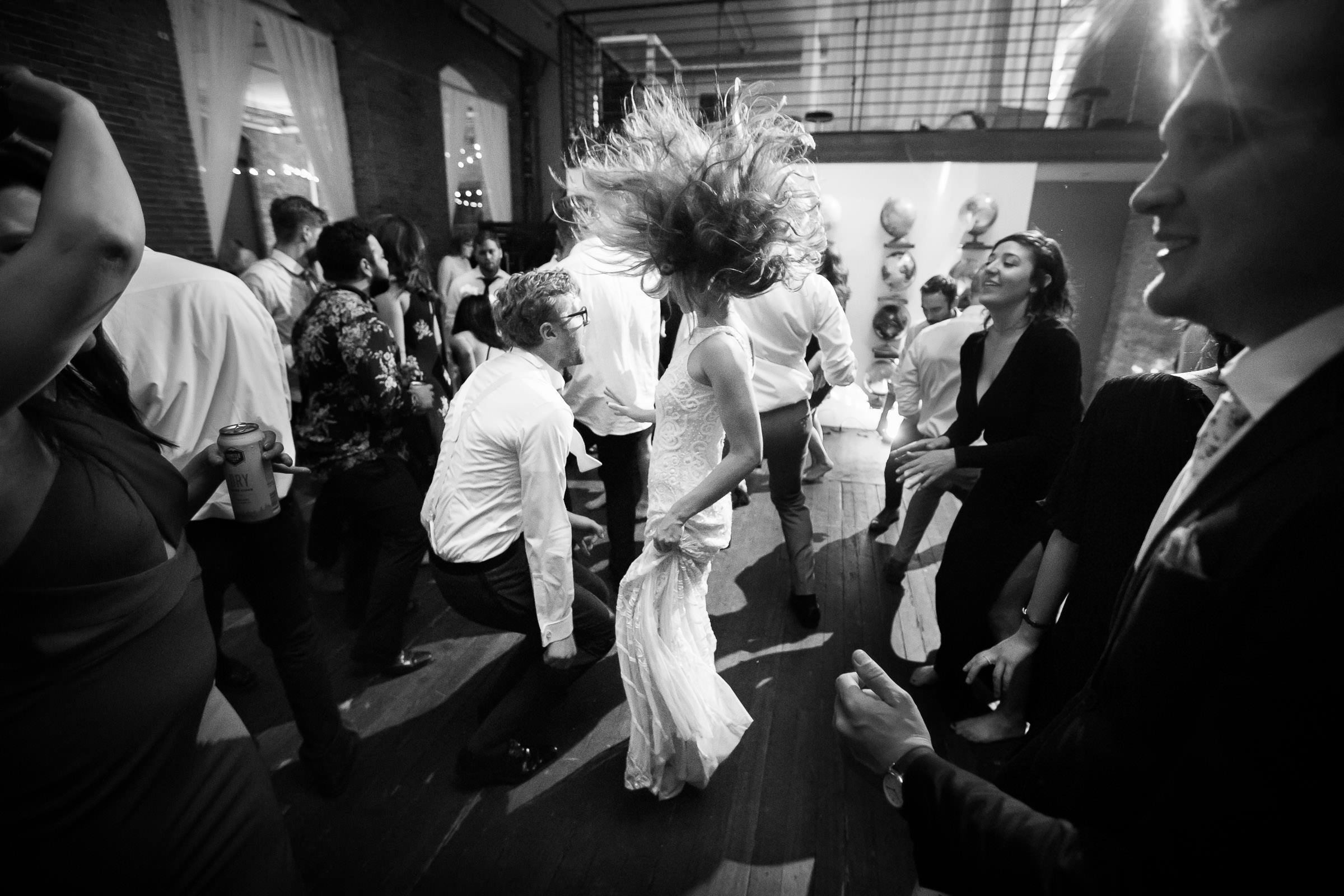 bride dancing with hair flying
