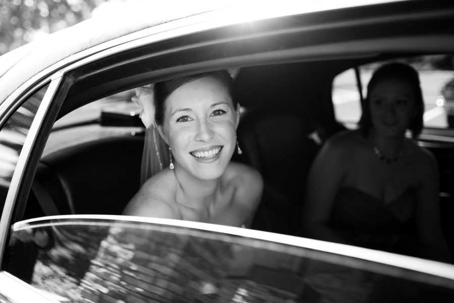 bride leaving for the ceremony in a car