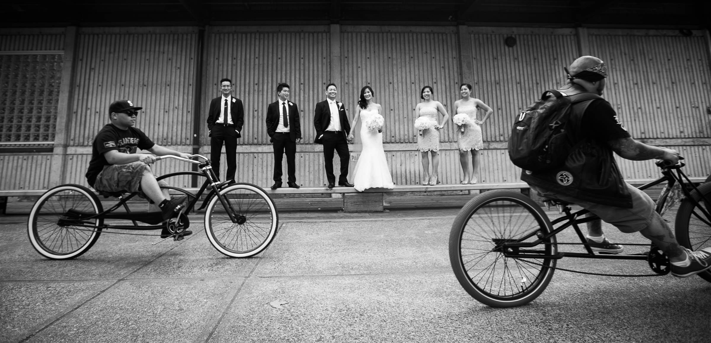 bicyclists photobombing the wedding party