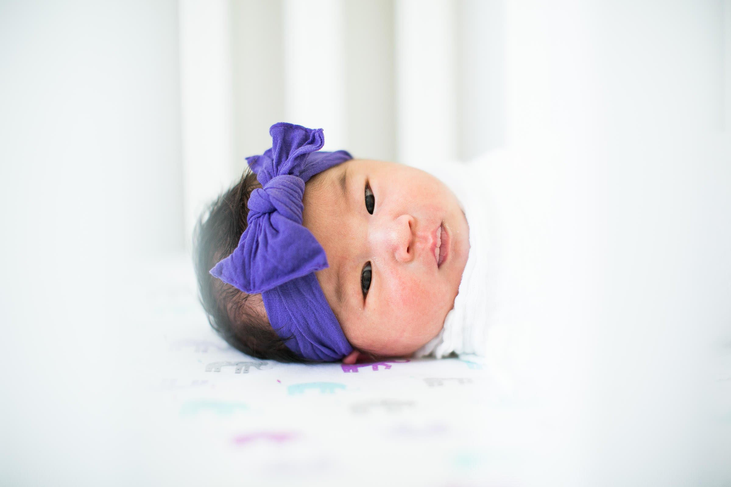 newborn girl with a bow in her hair